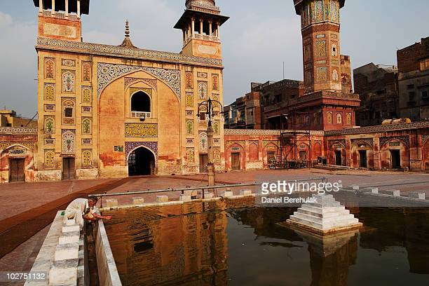 Muslim man washes himself before prayer in the Wazir Khan Mosque in the walled city of Old Lahore on July 9 2010 in Lahore Pakistan The Mosque was...