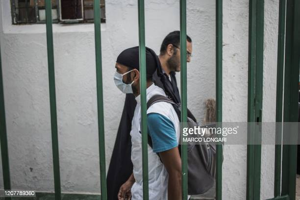 A Muslim man wearing a mask as a preventive measure against the COVID19 coronavirus arrive to perform the Friday prayer at the 23rd Street in the...