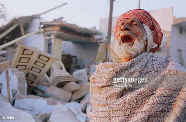 Muslim man weeps infront of his destroyed house January 29, 2001 in Bhuj, India. Bhuj and the surrounding villages in the western indian state of...