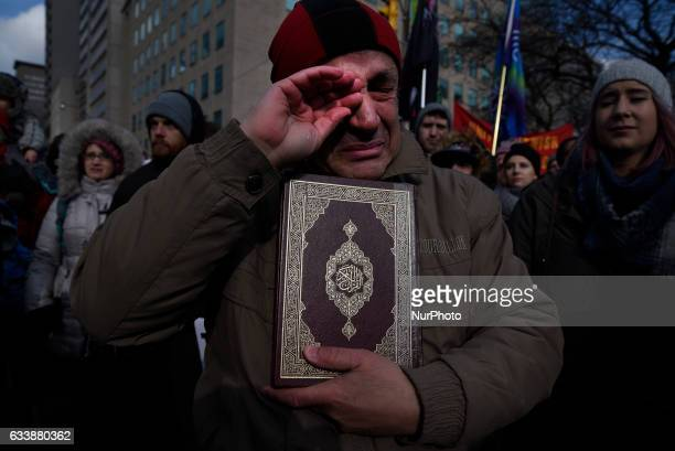 A Muslim man wiping his tears while holding the holy quotQuranquot during a rally against Islamophobia amp White Supremacy in Toronto Canada on 4...