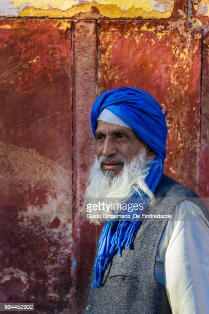 Muslim man with blue turban and white beard at the mosque, New Delhi, India