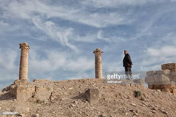 Muslim man with skul cap on top of sanliurfa castle
