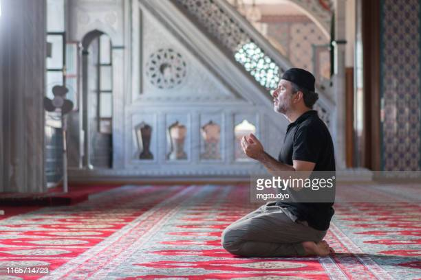 muslim mature men prayer in mosque - friday stock pictures, royalty-free photos & images