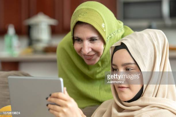 muslim mature woman posing with her young daughter - moroccan girls stock photos and pictures