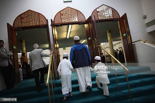 Muslim men and boys arrive to pray before Iftar the evening meal in the Muslim holy month of Ramadan at the London Muslim Centre on August 18 2010 in...