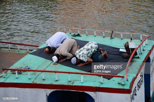 Muslim men are seen praying on a boat in the Buriganga river. Dhaka is getting back to its normal life after months of the ongoing Covid-19 pandemic.