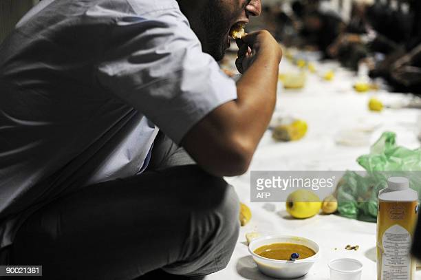 Muslim men break the fast at the AnNour mosque on the first day of the holy fasting month of Ramadan in Mulhouse on August 22 2009 During Ramadan...