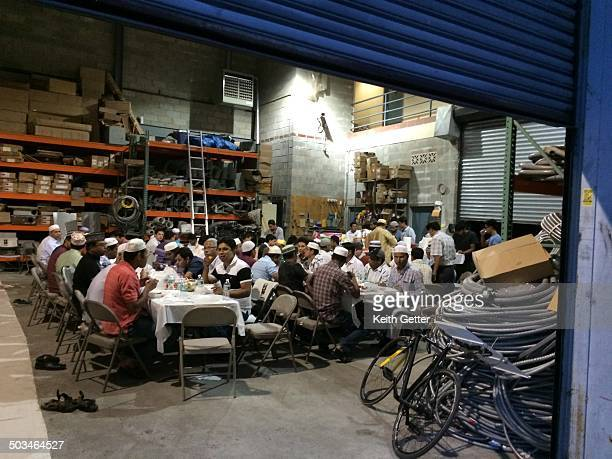 Muslim Men Breaking Ramadan Fast with a Group Meal in their Company's Warehouse on Dean Street near Classon Avenue in Brooklyn NY July 2014