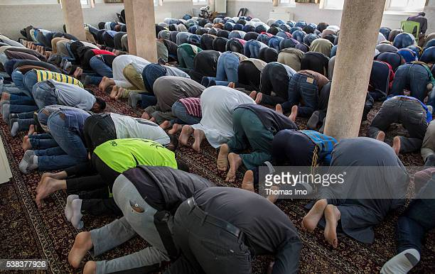 Muslim men during the Friday prayer in a mosque on April 08 2016 in Sweileh Jordan