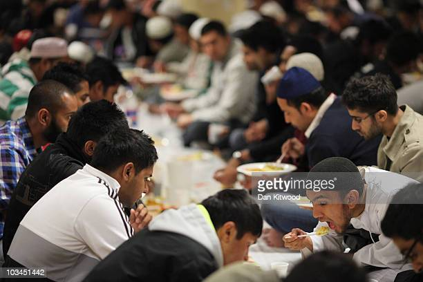 Muslim men eat during Iftar the evening meal in the Muslim holy month of Ramadan at the London Muslim Centre on August 18 2010 in London England...