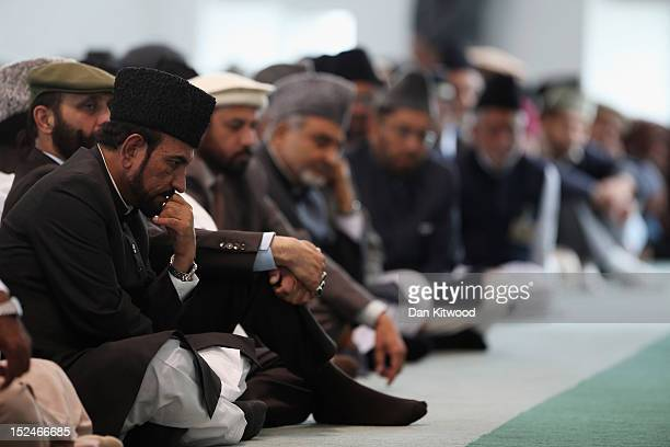 Muslim men listen to a speach by the Islamic Khalifa of the Ahmadiyya Muslim community Mirza Masroor Ahmad at Baitul Futuh Mosque in Morden on...
