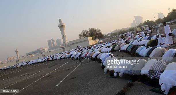 Muslim men perform the early morning Eid alFitr prayers marking the end of the holy month of Ramadan on September 10 at the Grand Musalla mosque in...