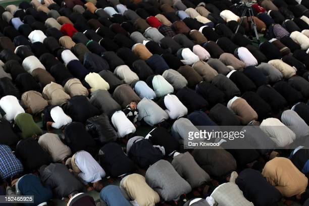 Muslim men pray after a speach by the Islamic Khalifa of the Ahmadiyya Muslim community Mirza Masroor Ahmad at Baitul Futuh Mosque in Morden on...