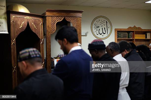 Muslim men pray at a mosque in Jersey City New Jersey on December 7 2015 Muslim American leaders accused Republican Presidential hopeful Donald Trump...