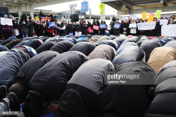 Muslim men pray at a prayer and demonstration at JFK airport to protest President Donald Trump's Executive Order banning immigrants and refugees from...