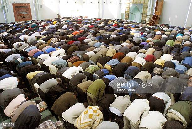 Muslim men pray before the start of their holy month of Ramadan at the Islamic Cultural Center of New York November 16 2001 in New York City...
