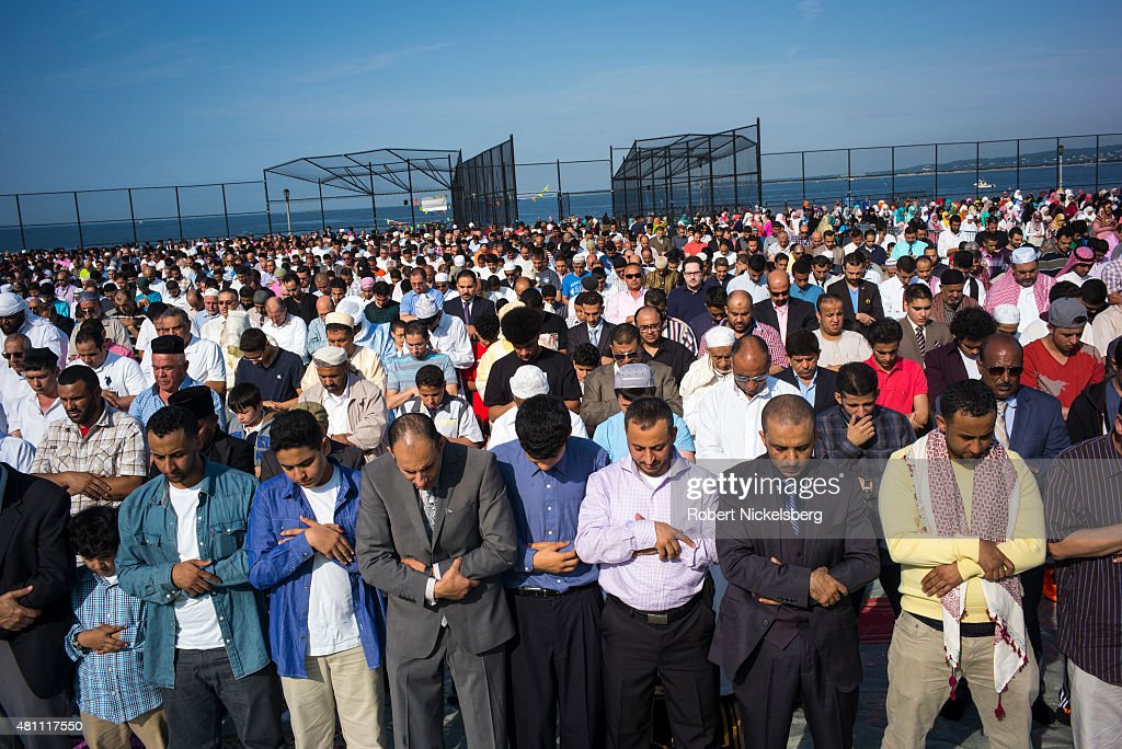 Muslim men pray during the traditional outdoor