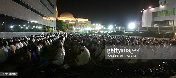 Muslim men pray in Kuwait City's Grand Mosque just before daybreak early 09 October 2007 during Laylat alQadr which falls on the 27th day of the holy...