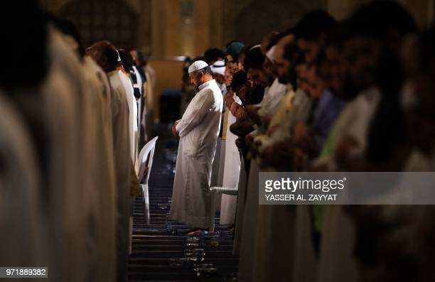 Muslim men pray in Kuwait City's Grand Mosque just before daybreak during Laylat alQadr or Night of Destiny during the holy month of Ramadan on June...