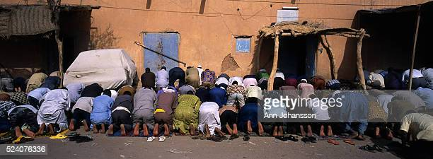 Muslim men pray in the city of Agadez in Niger | Location Agadez Africa