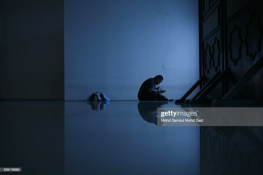 Muslim men rest inside the India Muslim mosque during the holy month of Ramadan on June 10, 2016 in Klang, Malaysia. Muslims around the world including Indonesia, Thailand and Arab state are observing the fasting month of Ramadan, Islam's holiest month, during which observant believers fast from dawn to dusk. They celebrate the end of the Ramadan with Eid al-Fitr festival.