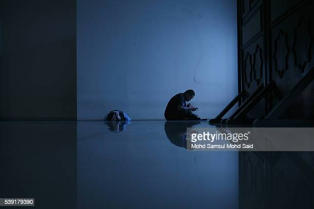 Muslim men rest inside the India Muslim mosque during the holy month of Ramadan on June 10 2016 in Klang Malaysia Muslims around the world including...