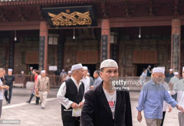 XI'AN SHAANXI PROVINCE CHINA Muslim men seen in the square in front of the main hall of the Xi'an Great Mosque many of them from other cities such as...