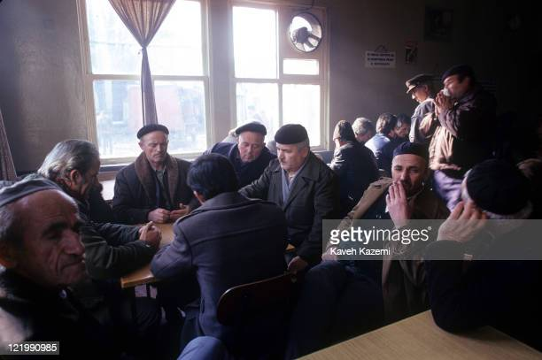 Muslim men sit around in a local cafe in Skopje, in the Republic of Macedonia, 27th December 1986.