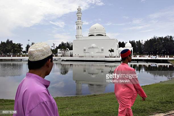 Muslim men walk towards the landmark Floating Mosque in Kuala Terengganu the capital of Terengganu State for congregational friday prayers 09...