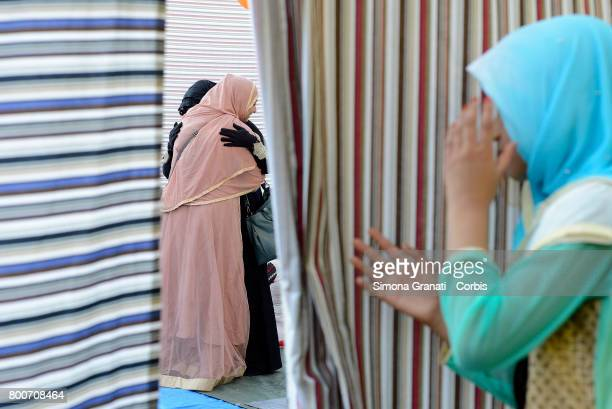 Muslim migrant in Torpignattara, a multiethnic suburb of Rome, for the prayer of Eid al-Fitr which marks the end of the Ramadan fasting month,on June...