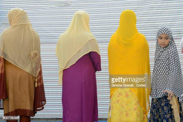 Muslim migrant in Torpignattara a multiethnic suburb of Rome for the prayer of Eid alFitr which marks the end of the Ramadan fasting monthon June 25...
