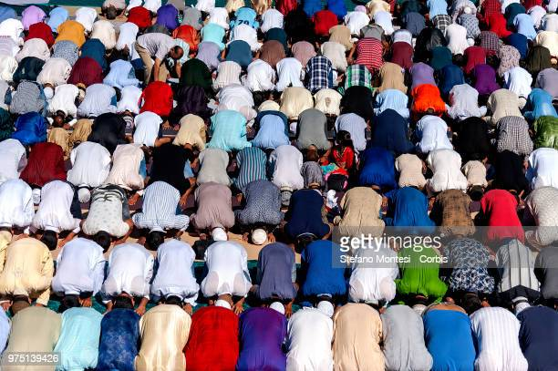 Muslim migrants attend prayer for Eid alFitr which marks the end of the Ramadan in Piazza Vittorio square Rome's Esquilino multiethnic quarter on...