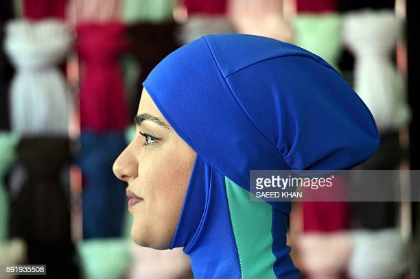 A muslim model display burkini swimsuits at a shop in western Sydney on August 19 2016 Part bikini part allcovering burqa the burqini swimsuit has...