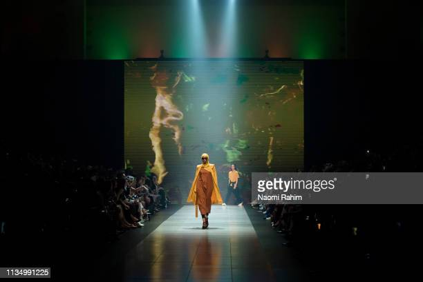 Muslim model, Hanan Ibrahim, showcases designs by Handsom at Melbourne Fashion Festival on March 9, 2019 in Melbourne, Australia.