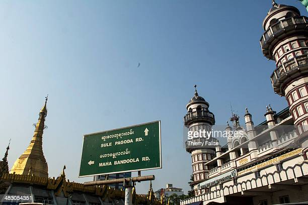 Muslim mosque stands near the Buddhist Sule pagoda in downtown Yangon