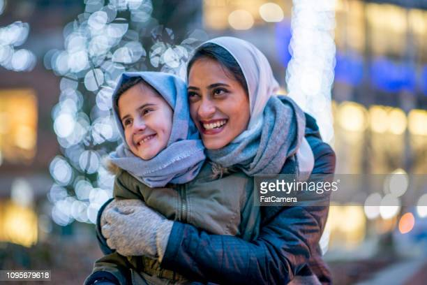 muslim mother and daughter - day stock pictures, royalty-free photos & images