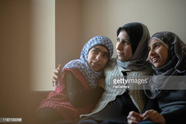 muslim mother and daughters stock photo - fatcamera stock pictures, royalty-free photos & images