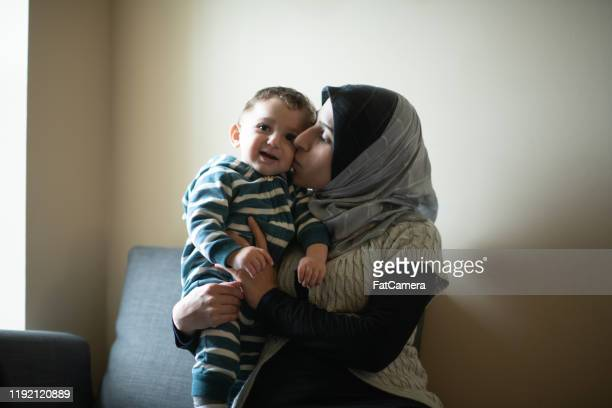 muslim mother and son stock photo - refugee stock pictures, royalty-free photos & images