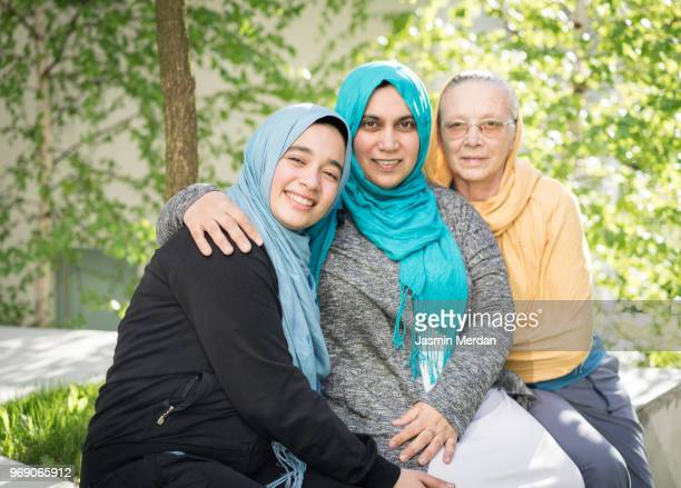 muslim multi generational family portrait - modest clothing stock pictures, royalty-free photos & images