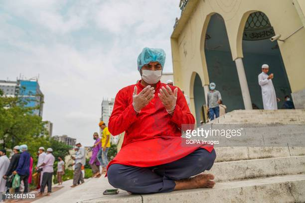Muslim offers prayers on the last Friday of the Islamic holy fasting month of Ramadan while wearing face masks as a preventive measure at the Baitul...