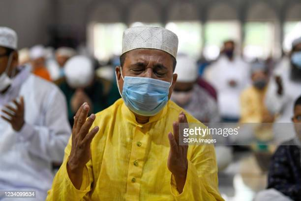 Muslim offers prayers to mark the start of the Muslim festival Eid al-Adha or the 'Festival of Sacrifice at Baitul Mukarram National Mosque in Dhaka.