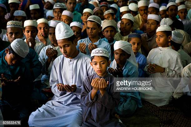 Muslim orphan boys living at a boy's madrassa listen to a senior cleric preach about Mohammed and lead them in koranic prayers A madrassa is an...