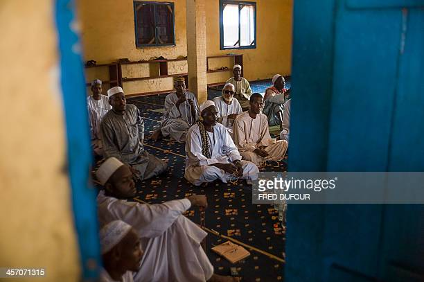 Muslim people are about to take part in a prayer at a mosque of Kina neighborhood an area where members of the two religions decided to unite to...