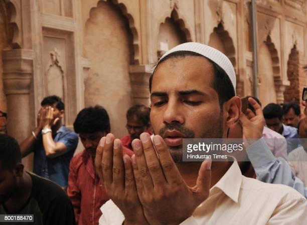 Muslim people are praying Alvida Namaz at Bara Imambara in Lucknow India on Friday June 23 2017