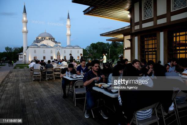 Muslim people attend an iftar on the first day of the holy month of Ramadan at Diyanet Center of America in Washington United States on May 06 2019