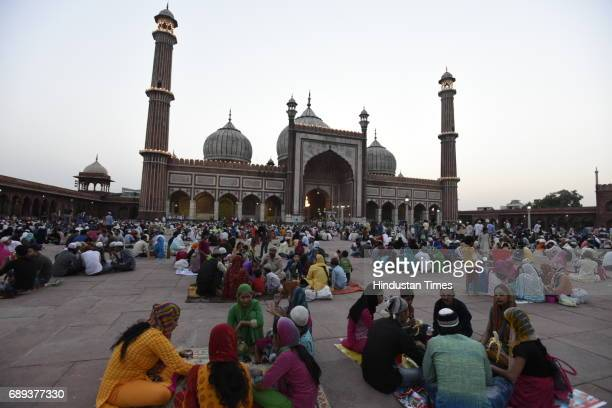 Muslim people gather at the historical Jama Masjid to break their first Roza as the holy month of Ramadan begins on May 28 2017 in New Delhi India...