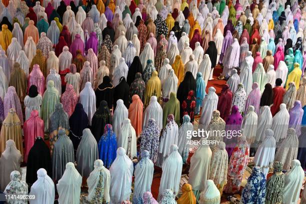 Muslim people pray on the first night of the holy month of Ramadan at the Istiqlal Grand Mosque in Jakarta on May 5 2019 Ramadan in Indonesia begins...