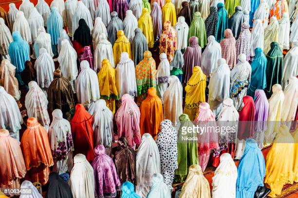 muslim people praying in istiqlal mosque, jakarta, indonesia - mosque stock pictures, royalty-free photos & images