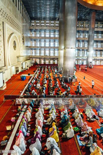 Muslim People praying in Istiqlal Mosque, Jakarta, Indonesia