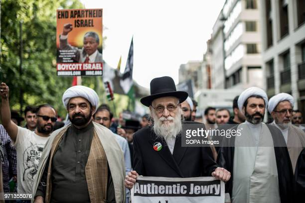 Muslim people seen in the head of the propalestine demonstration Hundreds of antiIsrael protesters marched through the streets on the annual Al Quds...